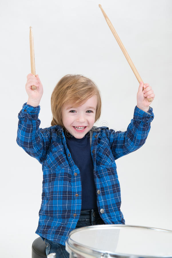 Boy playing drums royalty free stock photo