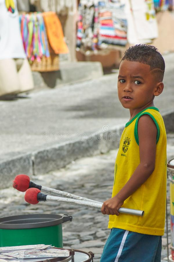 Boy playing drums in Pelourinho, Bahia royalty free stock photography