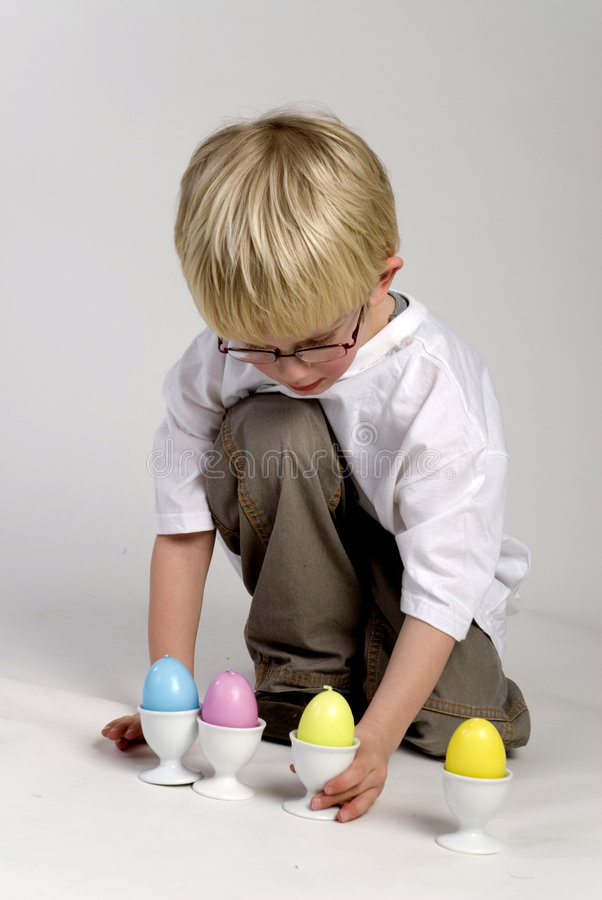 Boy is playing with egs. Boy is playing with easter eggs stock photos