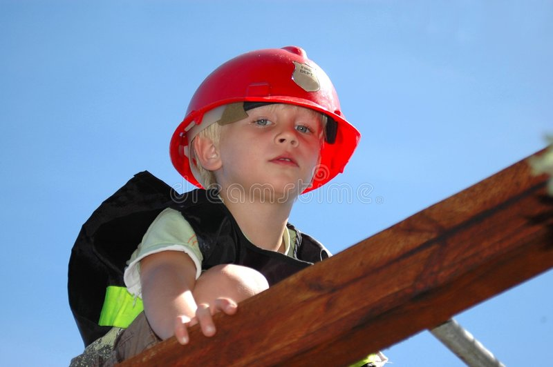 Boy playing firefighter royalty free stock photography