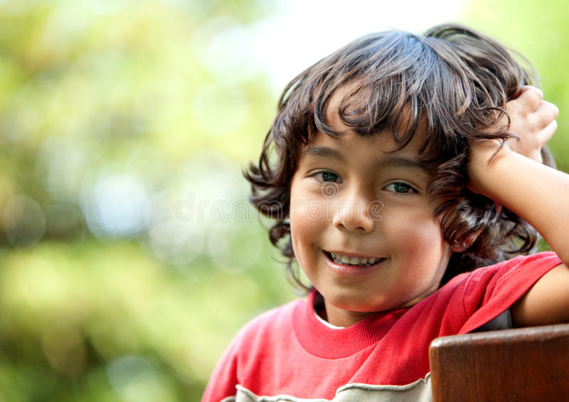 Download Boy playing with a flower stock image. Image of flower - 13643055