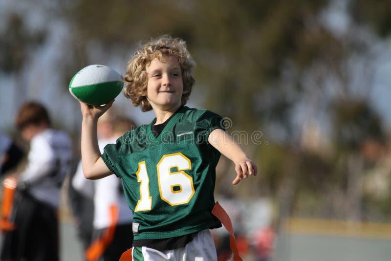 Boy playing football stock photos