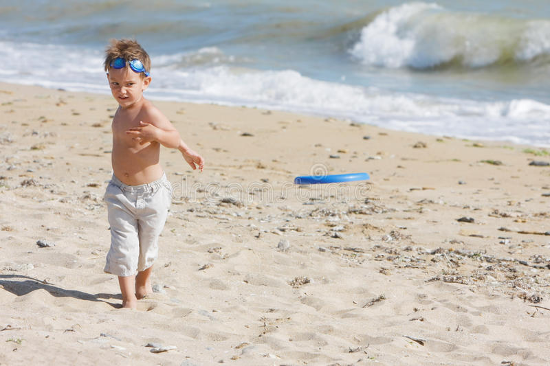 Download Boy Playing Frisbee On Beach Stock Image - Image: 14676707