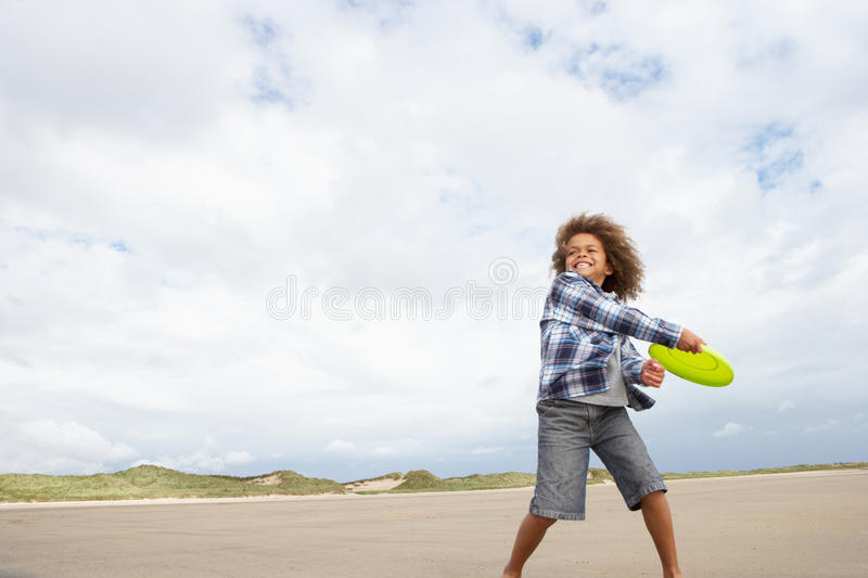 Boy Playing Frisbee On Beach Stock Photos