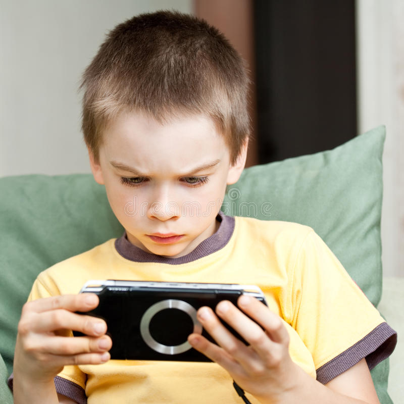 Download Boy Playing Game Console Royalty Free Stock Photos - Image: 11372358