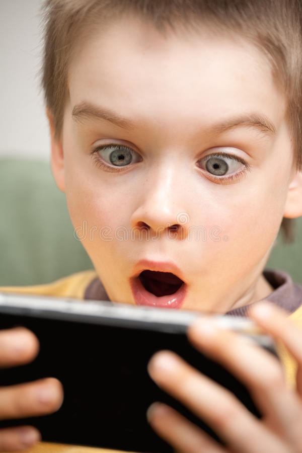 Download Boy playing game console stock image. Image of modern - 15268721
