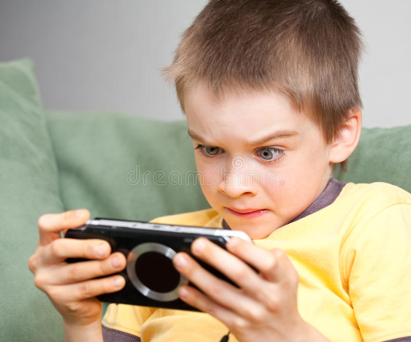 Download Boy Playing Game Console Royalty Free Stock Photo - Image: 9990835