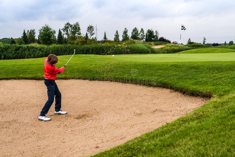 Boy playing golf stock image