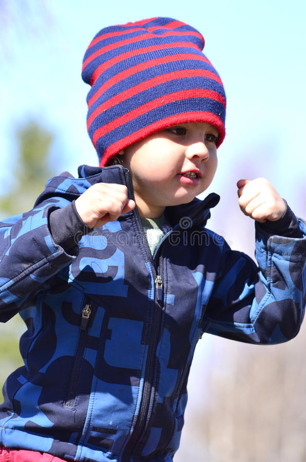 Download Boy playing stock image. Image of fist, shirt, schoolmates - 30884295