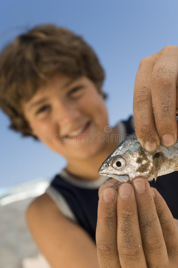 Boy Playing With His Catch Stock Photography