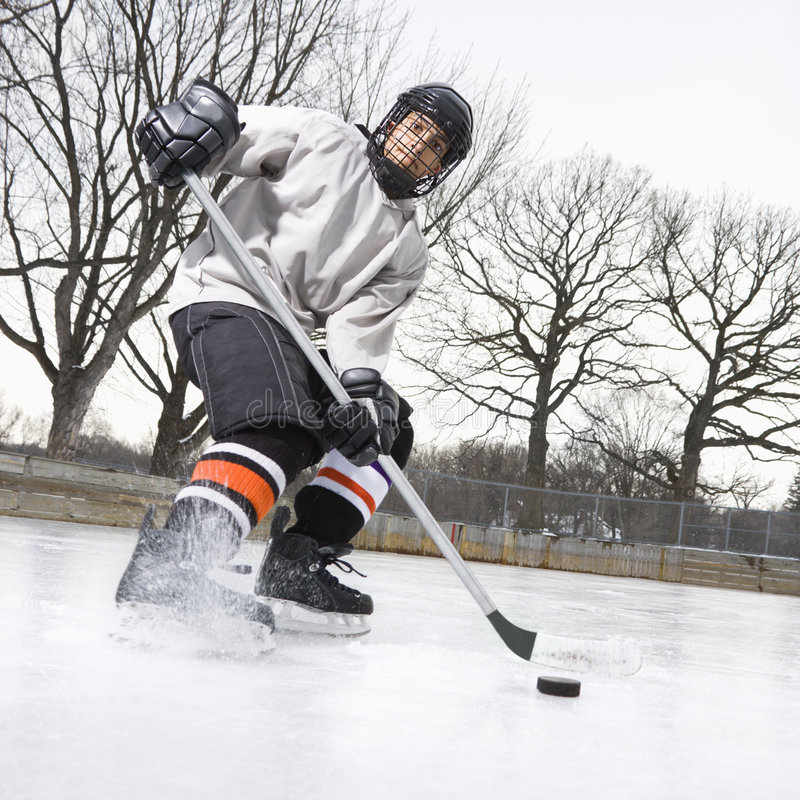 Download Boy playing ice hockey. stock photo. Image of color, shot - 3550980