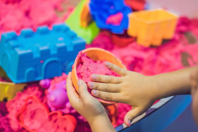 Boy playing with kinetic sand in preschool. The development of f. Ine motor concept. Creativity Game concept royalty free stock images