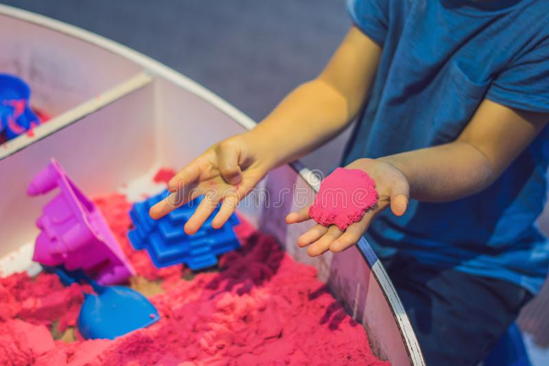 Boy playing with kinetic sand in preschool. The development of fine motor concept. Creativity Game concept.  stock image