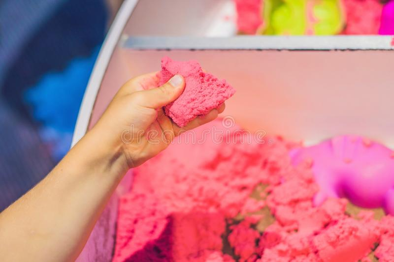 Boy playing with kinetic sand in preschool. The development of fine motor concept. Creativity Game concept.  stock photos