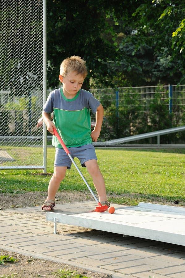 Download Boy playing mini golf stock photo. Image of preschooler - 19970222