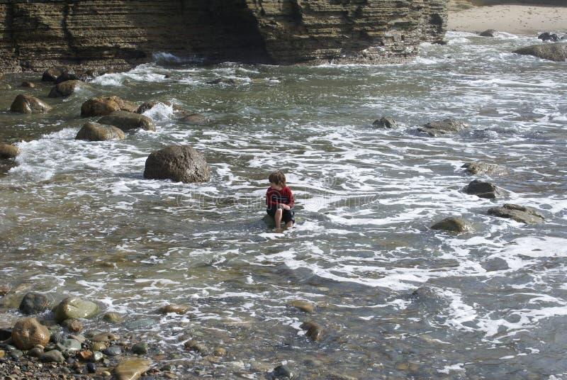 Boy Playing in Ocean royalty free stock photos