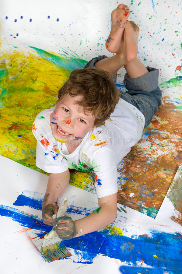 Download Boy playing with painting stock image. Image of colorful - 5553421