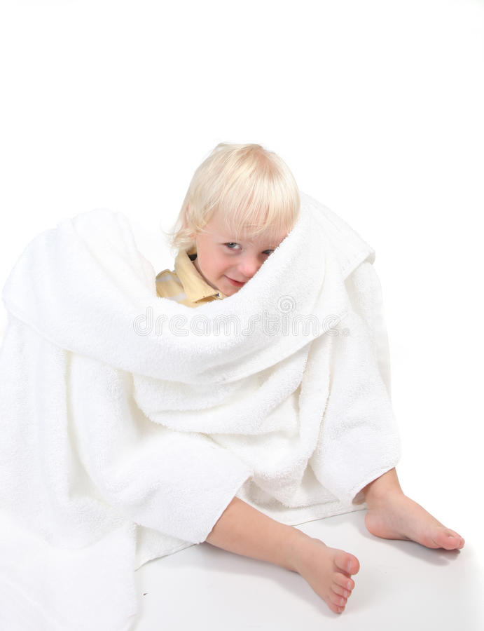 Boy Playing Peek a Boo With a Towel. Baby Boy Playing Peek a Boo With a Towel on White royalty free stock image