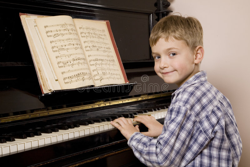 Download Boy playing the piano stock image. Image of playing, casual - 6831639