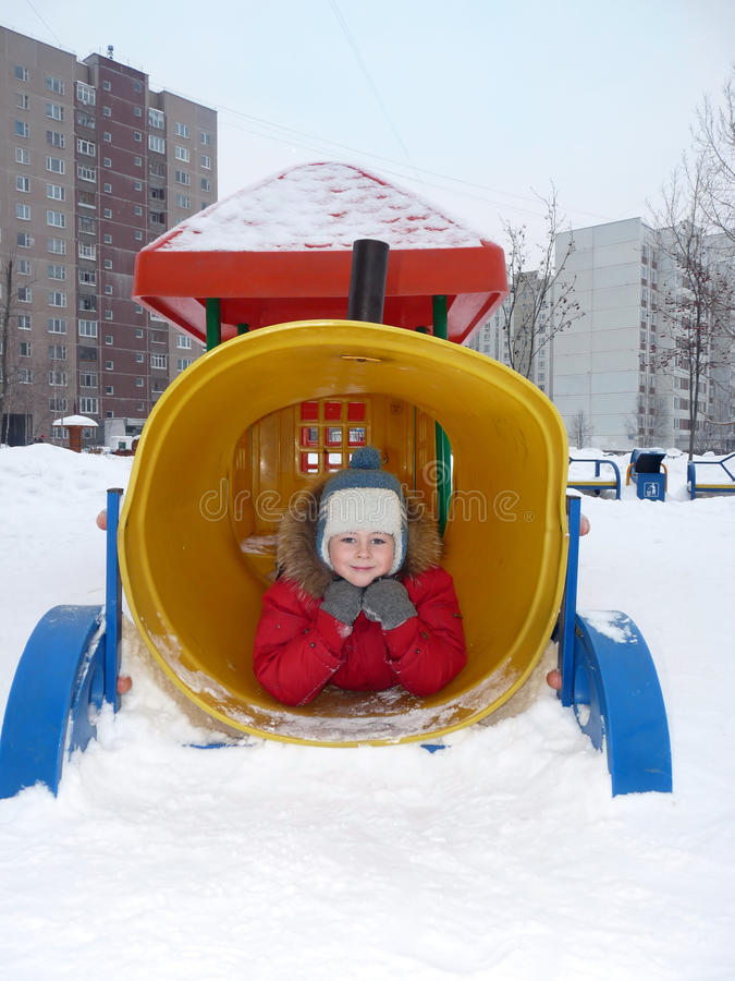 A Boy Playing On The Playground Stock Images