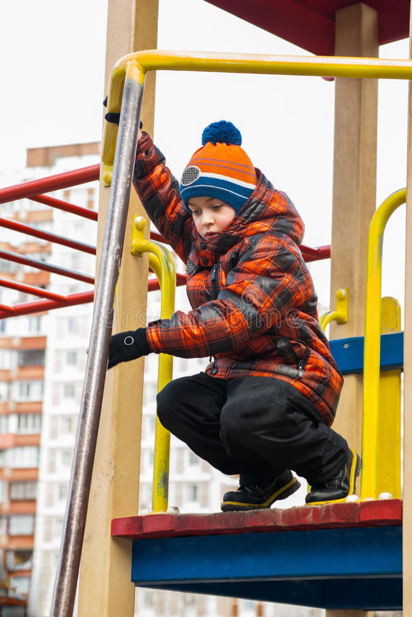 Boy playing on the playground royalty free stock photo