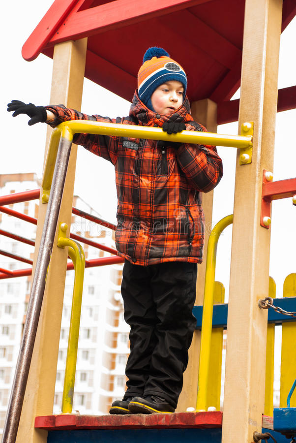 Boy playing on the playground stock image