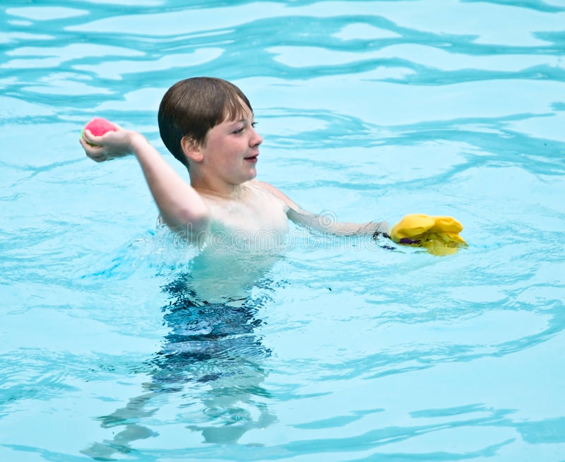 Download Boy Playing In The Pool Royalty Free Stock Images - Image: 9437579
