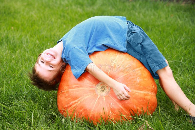 Download Boy Playing on Pumpkin stock photo. Image of gourds, domestic - 3305614
