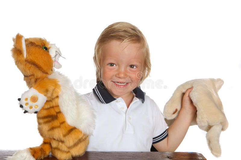 Boy playing puppet show royalty free stock photo