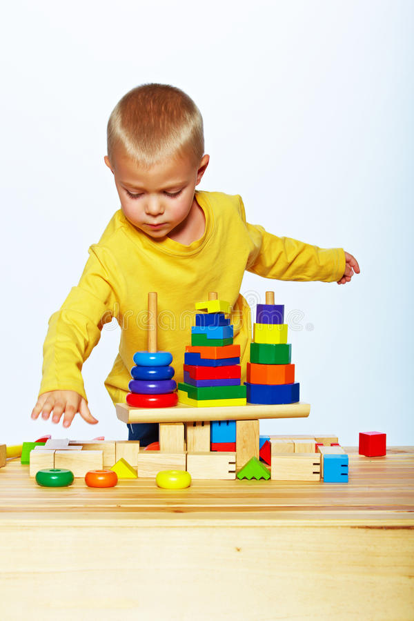 Download Boy playing with pyramid stock photo. Image of pyramid - 25136800