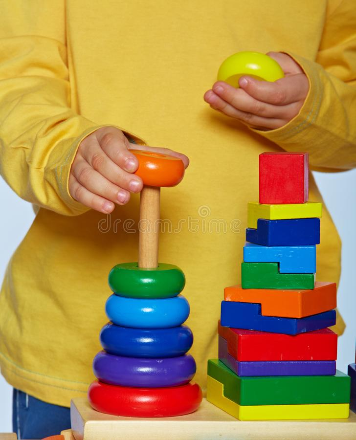 Boy playing with pyramid stock photography