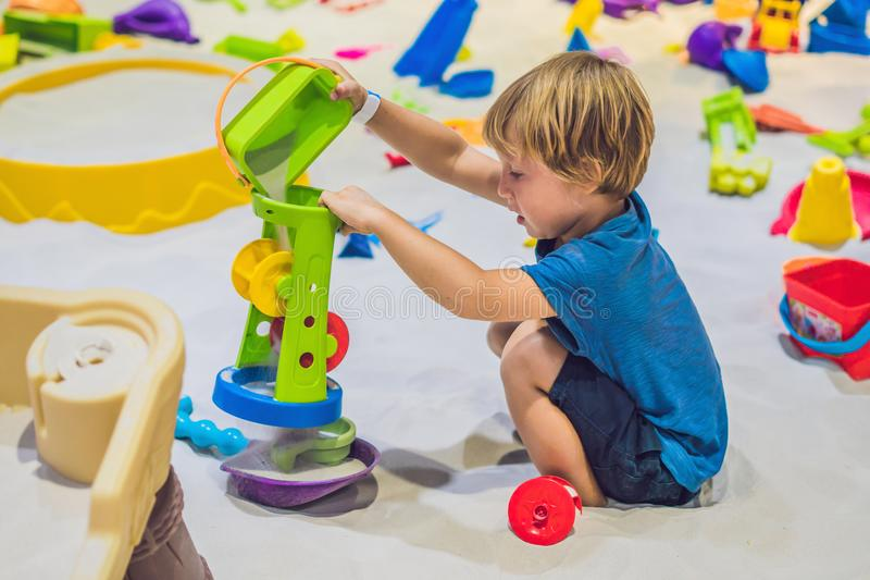 Boy playing with sand in preschool. The development of fine motor concept. Creativity Game concept.  royalty free stock photo