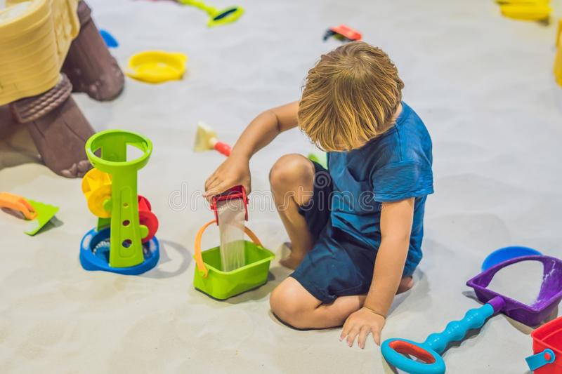 Boy playing with sand in preschool. The development of fine motor concept. Creativity Game concept.  stock image