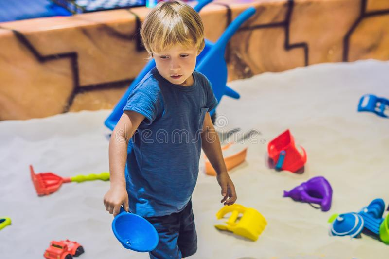Boy playing with sand in preschool. The development of fine motor concept. Creativity Game concept.  royalty free stock photography