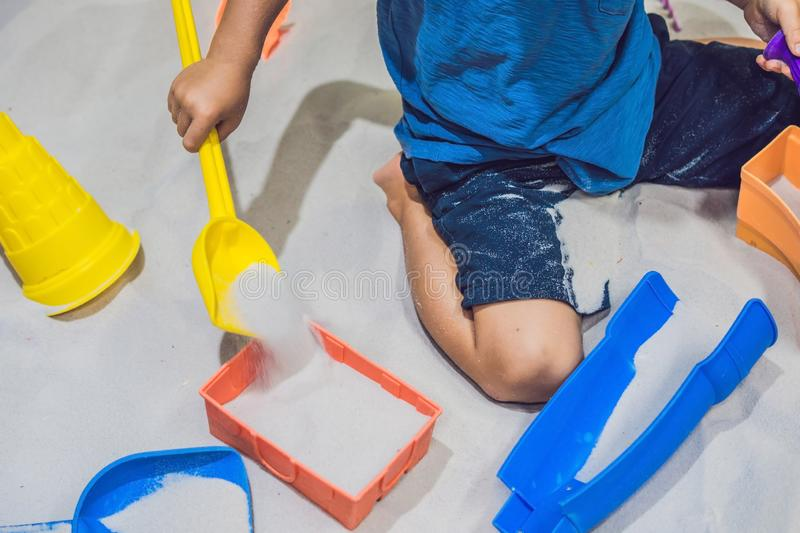Boy playing with sand in preschool. The development of fine motor concept. Creativity Game concept.  royalty free stock images