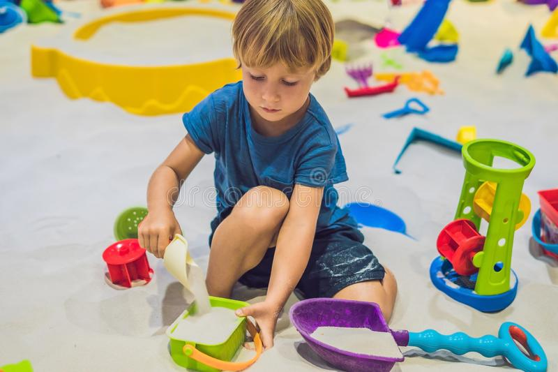 Boy playing with sand in preschool. The development of fine motor concept. Creativity Game concept.  royalty free stock image
