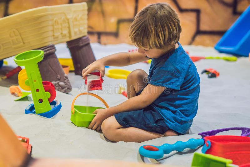 Boy playing with sand in preschool. The development of fine motor concept. Creativity Game concept.  royalty free stock photos