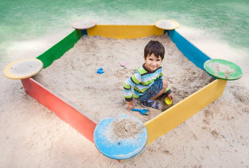 Download Boy playing in sandbox stock photo. Image of game, action - 26570200