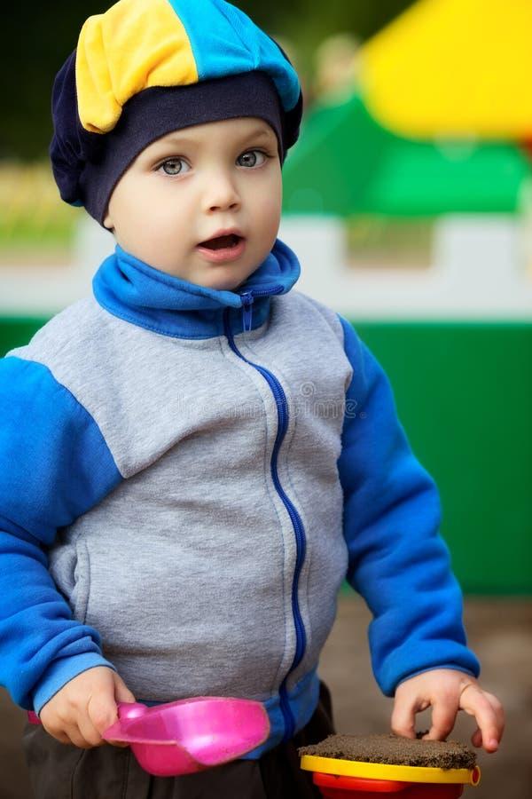 Boy Playing In Sandbox Stock Image