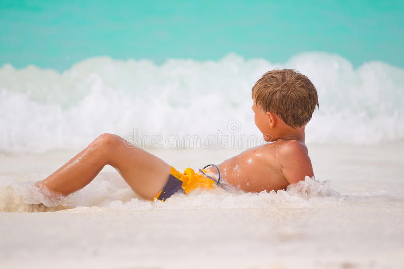 Boy playing in sea royalty free stock photos