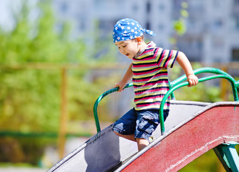 Download Boy playing on slide stock photo. Image of playground - 24668592