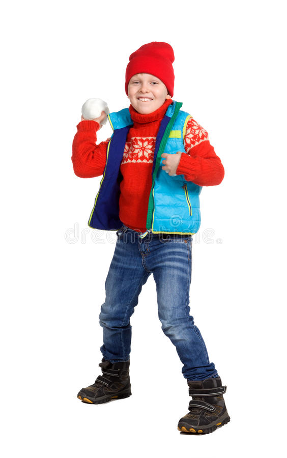 Boy playing in the snow royalty free stock image