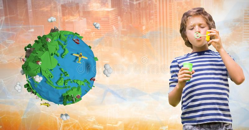 Boy playing with soap bubbles by low poly earth royalty free stock photo