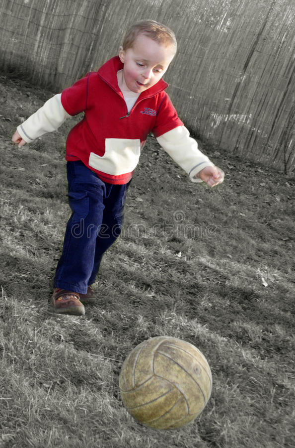 Download Boy playing soccer stock image. Image of meadow, grass - 10099911