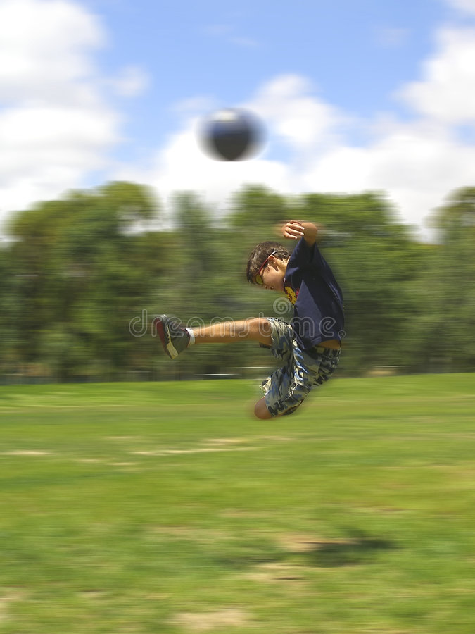 Boy playing soccer royalty free stock photography
