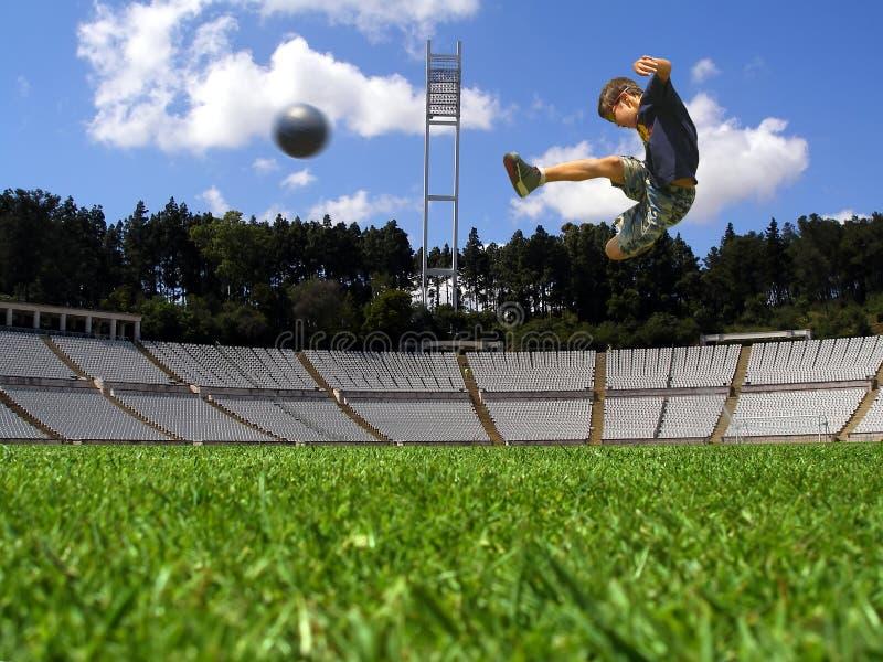 Boy playing soccer stock image