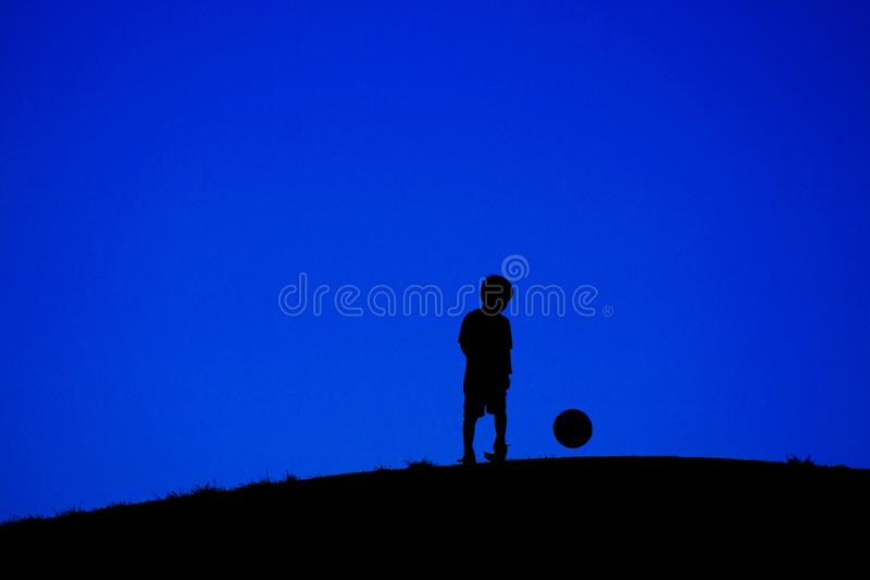 Boy playing with a soccer ball without wires stock photography