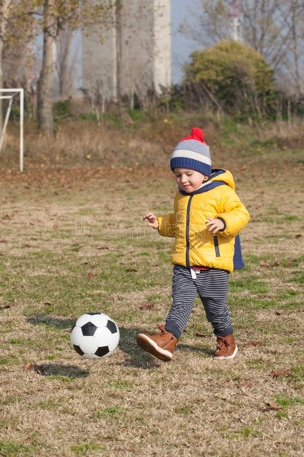 Little boy playing with soccer or football ball. sports for exercise and activity. Boy playing with soccer or football ball. sports for exercise and activity royalty free stock images