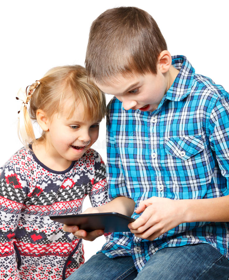 Children playing with a tablet computer royalty free stock photo