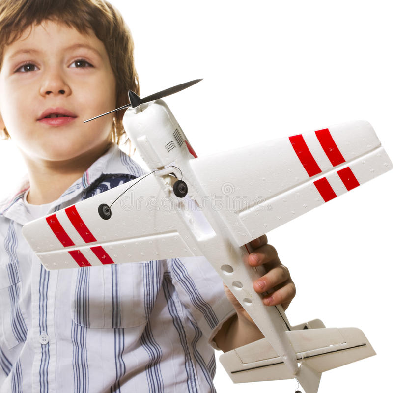 Boy playing with a toy airplane. Boy with toy airplane isolated on white royalty free stock photos